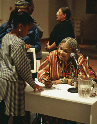 Katherine Dunham and a young admirer, at MOCRA, 1993. Dunham's legacy lives on in new generations of dancers.