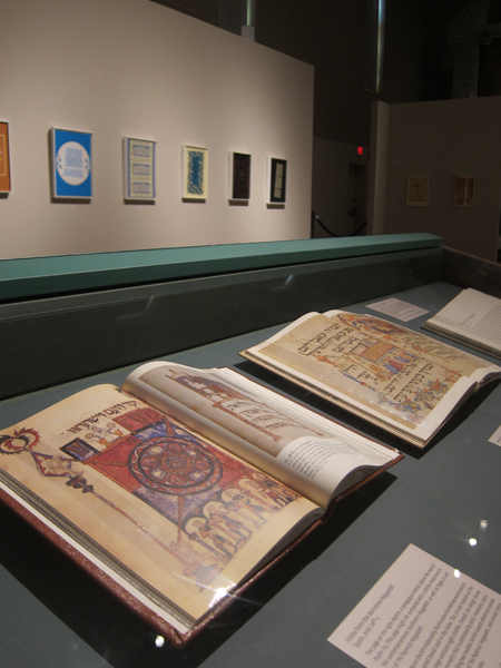 Reproductions of historical Haggadot on display at MOCRA.