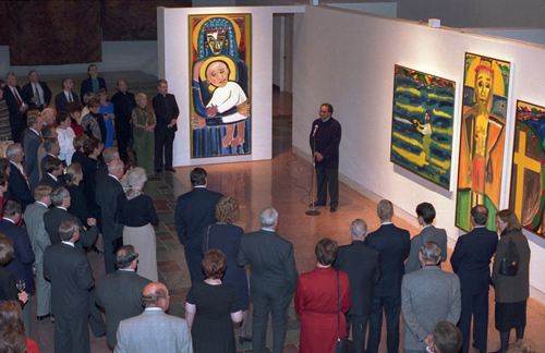 "Frederick J. Brown addressing the attendees at the 1995 opening of his ""The Life of Christ Altarpiece"" at the Museum of Contemporary Religious Art (MOCRA), Saint Louis University, St. Louis, MIssouri."