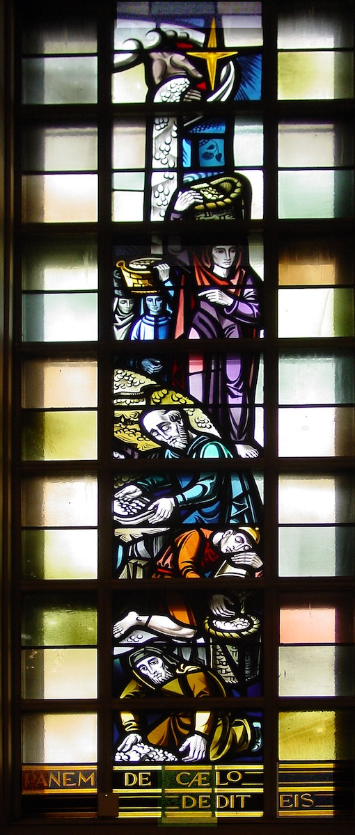 Stained glass window in Fusz Memorial Chapel, Saint Louis University: The miracle of manna in the desert.