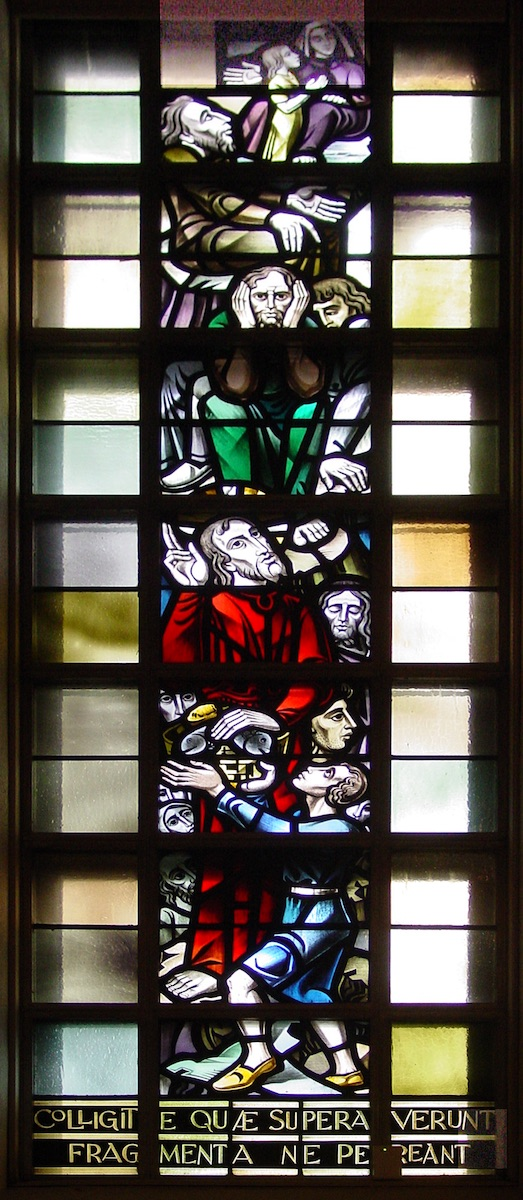 Stained glass window in Fusz Memorial Chapel, Saint Louis University: The miracle of the loaves and fishes.